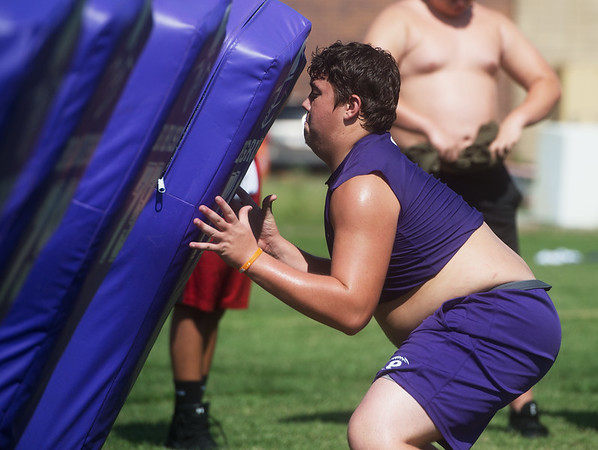 Pittsburg's Shay Mahnken runs through a drill during practice at Pittsburg High School.<br /> Globe | Roger Nomer