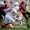 Joplin runningback Nathan Glades (6) gets past a host of Seneca defenders during Joplin's Jamboree on Friday night at Junge Stadium.<br /> Globe | Laurie Sisk