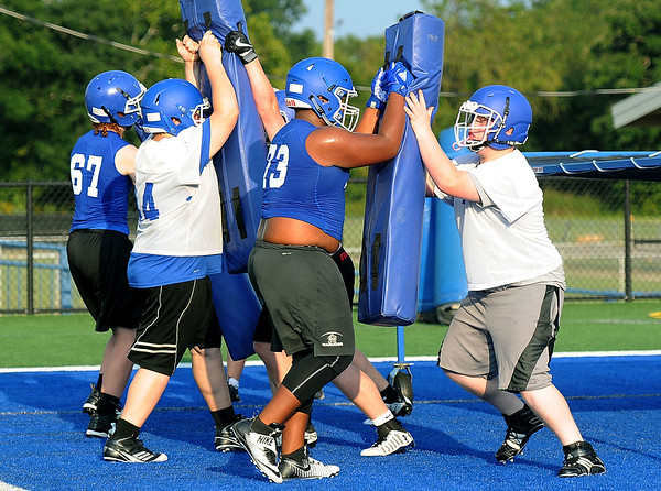 Miami linemen run through drills during practice at Northeastern Oklahoma A&M on Wednesday night .<br /> Globe   Laurie Sisk