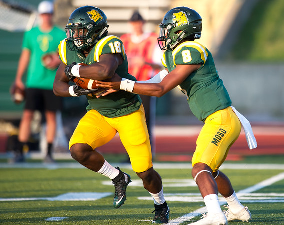 Missouri Southern quarterback Dante Vandeven (8) hands off to runningback Josh Hadley (18) during their season opener against Fort Hays State on Thursday night at Fred G. Hughes Stadium. <br /> Globe | Laurie Sisk