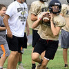 Neosho Head Coach Leon Miller looks on as quarterback Quincy Willis runs passing drills during practice on Friday at NHS.<br /> Globe   Laurie Sisk