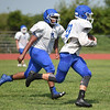 Caden Folks, right,  runs the ball during practice on Saturday morning at MHS.<br /> Globe | Laurie Sisk