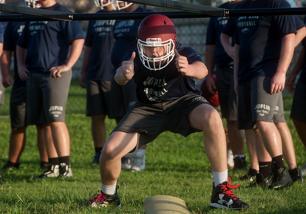 Jett Steele runs through a drill during his first day of practice on Monday at Joplin High School.<br /> Globe | Roger Nomer