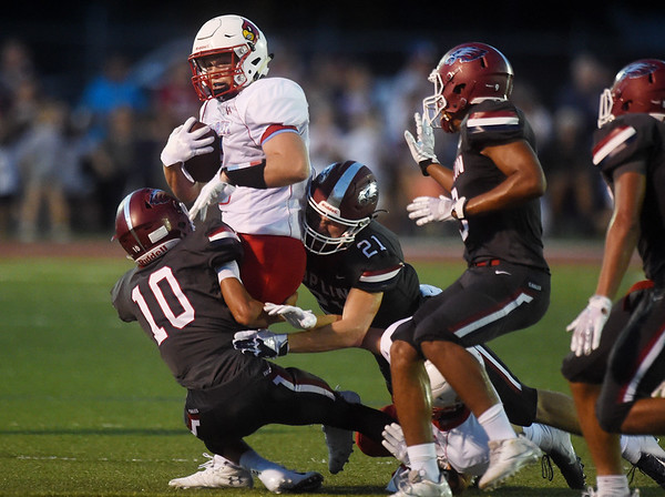 Webb City's Alex Gaskill is tackled by Joplin's DaRon Morgan (10) and Nic Lewis (21) during Friday's game at Joplin.<br /> Globe | Roger Nomer