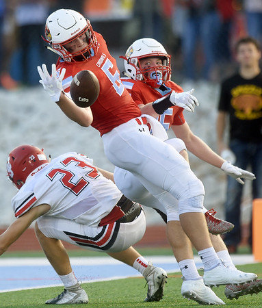 Webb City's Alex Gaskill (6) breaks up a pass in the end zone intended for Carl Junction receiver Lance Ward (23) as Cale McAllister (15) looks on during their season opener on Friday night at Webb City.<br /> Globe | Laurie Sisk