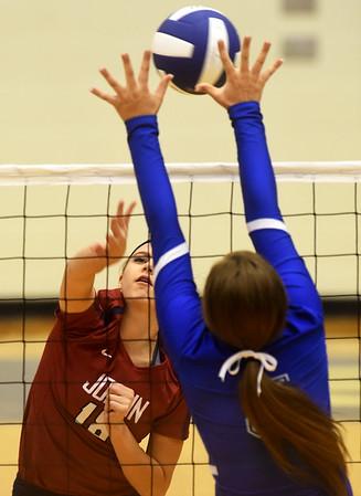 Joplin's (18) tries to get a spike past Carthage's Jaxsyn Anderson (5) during the Carthage Volleyball Jamboree on Tuesday night at Carthage High School.<br /> Globe | Laurie Sisk