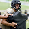 Neosho lineman Drew Osborn runs through drills on the sled during practice on Friday at NHS.<br /> Globe | Laurie Sisk