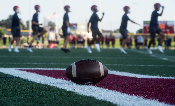 Joplin football players run through a warm up during their first day of practice on Monday at Joplin High School. Globe | Roger Nomer