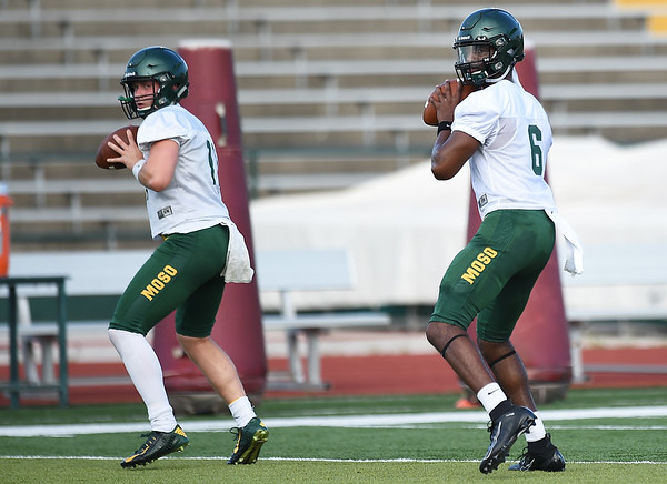 From the left: Missouri Southern quarterbacks Sean Kelly and Dwayne Lawson go through drills during their first practice of the season on Friday night at Fred G. Hughes Stadium.<br /> Globe | Laurie Sisk