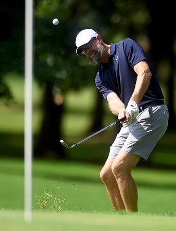 Joplin's Greg Crawford watches his chip shot on its way to the pin during his Ky Laffoon Cup matchup on Saturday at the Carthage Golf Course.<br /> Globe | Laurie Sisk