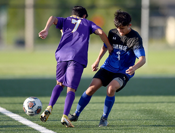 Carthage's Carlos Salas (16) tries to get past Monett's Loger Rodriguez (7) during their scrimmage at the Joplin Jamboree on Tuesday night at Joplin High School.<br /> Globe | Laurie Sisk