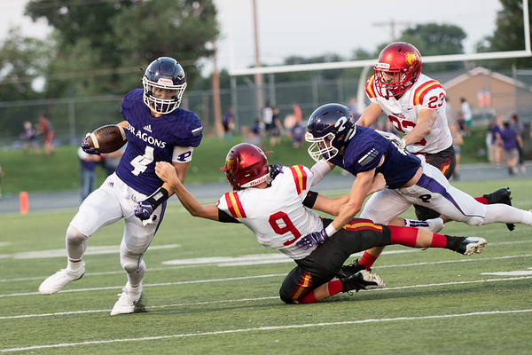 Pittsburgs's Dylan White breaks a tackle from Labette County's Russell McCarty at Friday's game in Pittsburg at Hutchinson Field.<br /> Globe | Reid Williams
