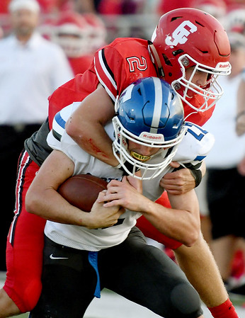 Carthage runningback Tyler Mueller (22) tries to get past Carl Junction defensive back Teagan Armentrout (2) during their game on Friday night at Carl Junction.<br /> Globe | Laurie Sisk