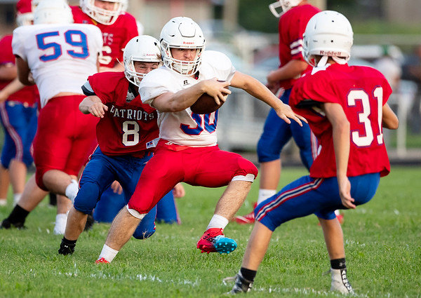 Patriot's Hunter Liveoak zig-zags his way around defenders as he runs the ball during practice on Saturday evening at East Newton High School.<br /> Globe|Israel Perez