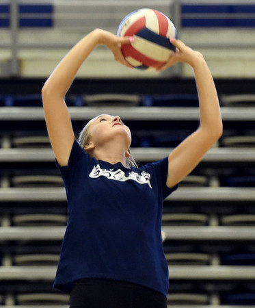 Joplin junior Mari Katheryn Saunders sets the ball during practice on Tuesday night at JHS. <br /> Globe | Laurie SIsk