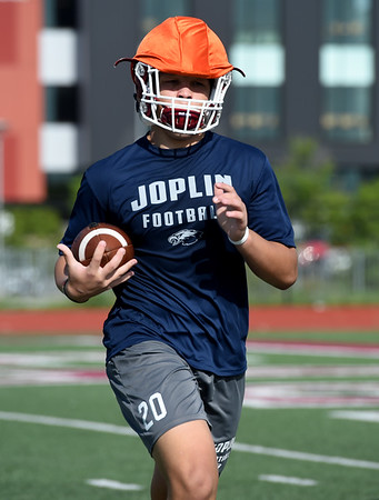 Joplin's Isaiah Davis, center, runs through conditioning drills during the first day of football practice on Monday morning at JHS.<br /> Globe   Laurie Sisk