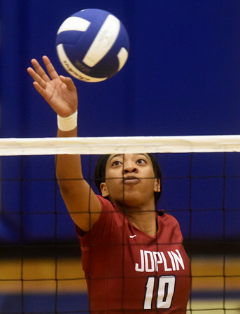 Joplin's Malia Mack tips the ball over the net during the Carthage Volleyball Jamboree on Tuesday night at Carthage High School.<br /> Globe | Laurie Sisk