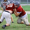 Nevada all-state lineman Peyton Denney, right, works on blocking drills with teammate Caleb Longobarti during practice on Wednesday at NHS.<br /> Globe | Laurie Sisk