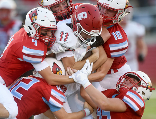 Carl Junction quarterback Joe Kennedy is greeted by a host of Webb City defenders during their season opener on Friday night at Webb City.<br /> Globe | Laurie Sisk