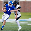 Miami's Wardogs Gavin Payton (7) runs the ball gaining yards as L-Ray Kirk of Jay gets ready to tackle on Friday evening at the Red Robertson Field in Miami Ok<br /> Globe|Israel Perez