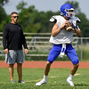 Miami quarterback Gavin Payton eyes his receivers as head coach Zach Gardner looks on during practice on Saturday morning at MHS.<br /> Globe | Laurie Sisk