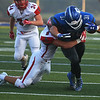 Carthage's Colton Winder is tackled by Nixa's Elliott Rule during Friday's game in Carthage.<br /> Globe | Roger Nomer
