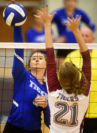 Carthage's Jaxsyn Anderson gets a spike past Nevada's Adrian Bond during the Carthage Volleyball Jamboree on Tuesday night at Carthage High School.<br /> Globe | Laurie Sisk
