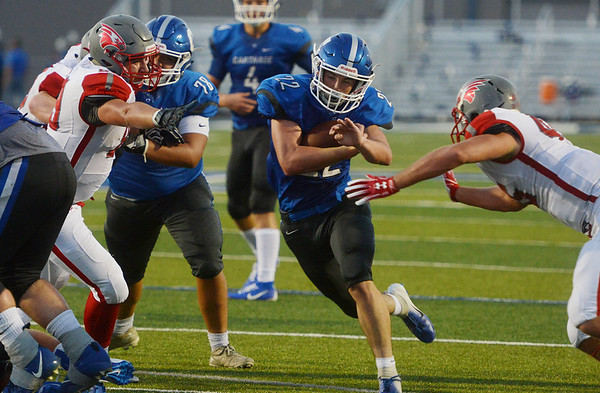 Carthage's Tyler Mueller finds a hole in the Nixa defense to score on Friday at Carthage.<br /> Globe | Roger Nomer