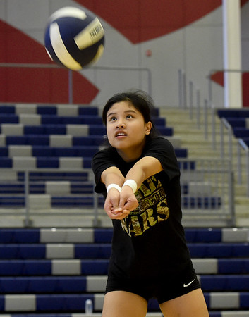 Joplin junior Jeanie Juneweeranong bumps to the setter during practice on Tuesday night at JHS. <br /> Globe   Laurie SIsk