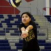 Joplin junior Jeanie Juneweeranong bumps to the setter during practice on Tuesday night at JHS. <br /> Globe | Laurie SIsk
