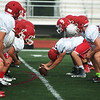 The Carl Junction football team practices on Wednesday.<br /> Globe | Roger Nomer