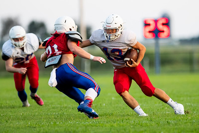 Patriot's Toukheng Xiong runs the ball with a gain of yards during practice on Saturday evening at East Newton High School. Globe|Israel Perez