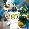 Fort Hays State's Tyler Bacon (28) climbs the ladder for a long reception as Missouri Southern linebacker EJ McKenzie (15) defends during their season opener on Thursday night at Fred G. Hughes Stadium. Also pictured is FHSU receiver Harley Hazlett (87.)<br /> Globe | Laurie Sisk