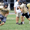 Neosho's Danny Fox runs a pass pattern as Gage Kelley looks to pass during practice on Friday at NHS.<br /> Globe   Laurie Sisk