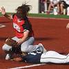 Joplin's Layni Merriman slides under the tag from McDonald County's Whitney Kinser on Monday at Joplin High School.<br /> Globe | Roger Nomer