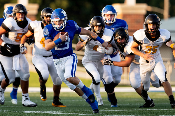Miami's Wardogs Caden Folks (23) runs the ball gaining yards during their game against the Bulldogs of Jay Ok on Friday evening at the Red Robertson Field in Miami Ok<br /> Globe|Israel Perez