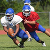 Miami's Alex Pulley secures a pass during practice on Saturday morning at MHS.<br /> Globe | Laurie Sisk