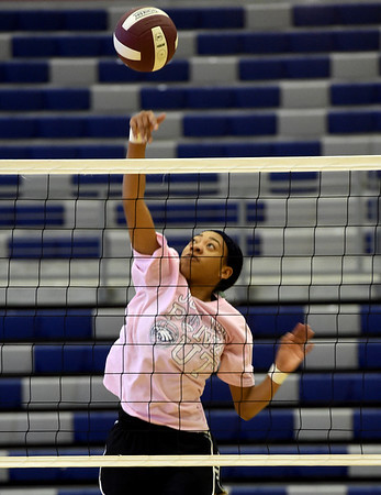 Joplin senior Malia Mack spikes the ball during practice on Tuesday night at JHS. MAck is one of two seniors on this year's squad.<br /> Globe | Laurie SIsk