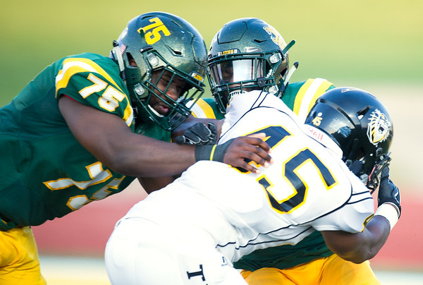 Missouri Southern's Jarrell Jackson (75) and Josh Hadley (18) try to bring down Fort Hays' Sterling Swopes (45) during their season opener on Thursday night at Fred G. Hughes Stadium. <br /> Globe | Laurie Sisk