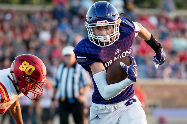Pittsburg's Brett Wiemers runs towards the sideline to set up a 32 yard field goal by Caden Bressler during Friday's game in Pittsburg at Hutchinson Field.<br /> Globe | Reid Williams