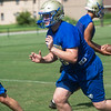 Riverton's Trevor Parsons runs through a drill at Riverton High School.<br /> Globe | Roger Nomer