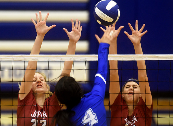 Joplin's xx (23) and xx (18) try to block a spike by Carthage's Paige Schrader (4) during the Carthage Volleyball Jamboree on Tuesday night at Carthage High School.<br /> Globe | Laurie Sisk