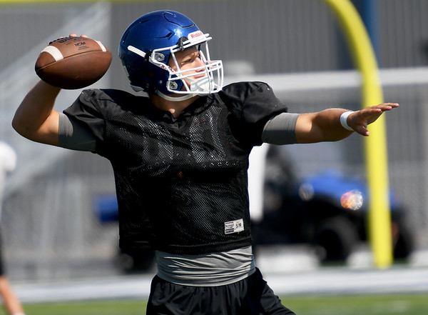 Carthage quarterback Zeke Sappington works on passing drills with his team during practice on Friday at the new David Haffner Stadium.<br /> Globe | Laurie Sisk