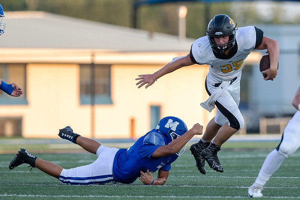 Jay's Bulldogs Zach Coy (35) runs the ball as he breaks the tackle of Jorge Moreno from the Miami's Wardogs on Friday evening at the Red Robertson Field in Miami Ok<br /> Globe Israel Perez