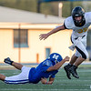 Jay's Bulldogs Zach Coy (35) runs the ball as he breaks the tackle of Jorge Moreno from the Miami's Wardogs on Friday evening at the Red Robertson Field in Miami Ok<br /> Globe|Israel Perez