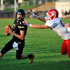 Neosho quarterback (1) looks for a pass under pressure from Ozark's Ethan Prichard (6) during Friday's game in Neosho.<br /> Globe | Willie Brown