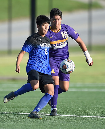 Carthage's Walter Mejia Contreras (6) tries to get past Monett's Jony Perez (16) during their scrimmage at the Joplin Jamboree on Tuesday night at Joplin High School.<br /> Globe   Laurie Sisk