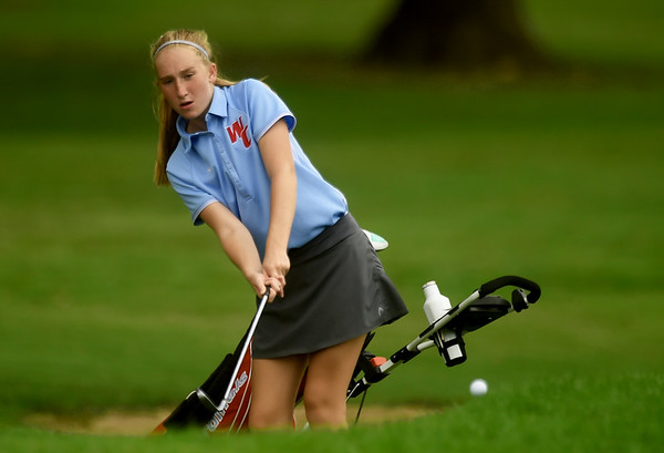 Webb City's Laya McAllister hits a chip shot onto the no. 9 green on Wednesday at the Carthage Golf Course.<br /> Globe | Laurie Sisk