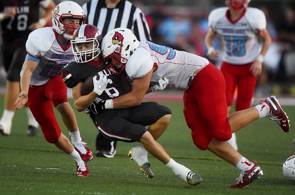 Joplin's Nathan Glades is tackled by Webb City's Kade Hicks (12) and Trenten Thompson (99) during Friday's game at Joplin.<br /> Globe | Roger Nomer