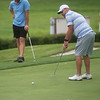 Sean Hamlett putts during Friday's Twin Hills Invitational.<br /> Globe | Roger Nomer